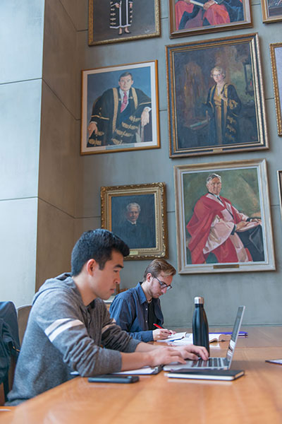 The University of British Columbia-students in campus room with pictures of past presidents