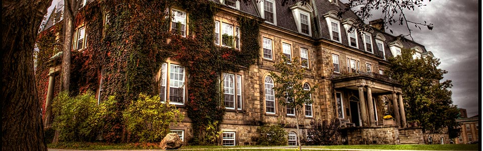 University of New Brunswick campus: campus building with vines covering it.