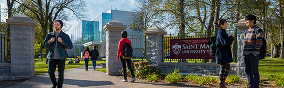 St Marys University_students walking on campus near school sign